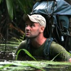 Ed Stafford wading in the Amazon River.
