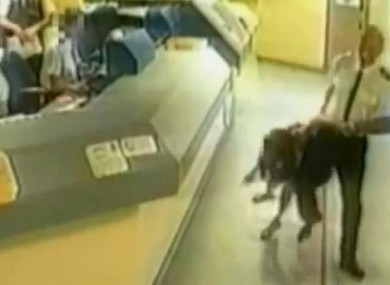 Sgt Mark Andrews drags Pamela Somerville through the Wiltshire police station.