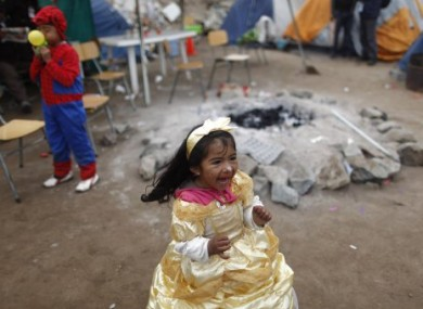 Lizet Gallardo, granddaughter of trapped miner Mario Gomez, plays at the San Jose mine near Copiapo, Chile on Sunday