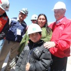 Chilean president Sebastian Pi–nera waits with the family of Victor Zamora, 33, the fourteenth trapped miner to be rescued from the San Jose mine near Copiapo, Chile on October 13, 2010.