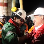 Chilean president Sebastian Pi–era hugs Luis Urzua, the last miner out of the rescue hole at the San Jose mine near Copiapo, Chile on October 13, 2010. HUGO INFANTE/GOVERNMENT OF CHILE