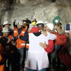 Chilean president Sebastian Pi–era embraces the doctor in charge of the triage medical stage as Luis Urzua became the last miner among the trapped miners to leave the San Jose mine near Copiapo, Chile on October 13, 2010. HUGO INFANTE/GOVERNMENT OF CHILE