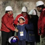 The son of Florencio Avalos cries as the capsule reaches the surface. HUGO INFANTE/GOVERNMENT OF CHILE