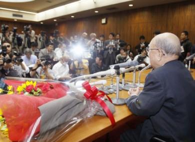 Hokkaido University professor emeritus Akira Suzuki speaks during a press conference at the university in Sapporo, Japan.