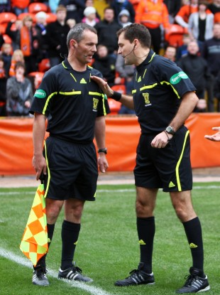 Referee Dougie McDonald talking to assistant Steven Caven during a Clydesdale Bank Scottish Premier League match.