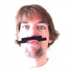 Dig out that childhood box of lego and make a man's mo' out of a boy's toy.<span class=