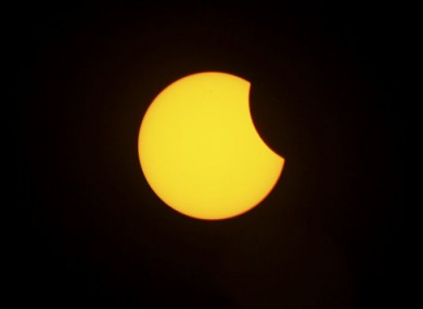 An annular solar eclipse is seen in the sky over Male, Maldives, Friday, Jan. 15, 2010.