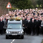 The dreadful aftermath of last week's airplane crash at Cork airport continued with the funerals of the six victims. This was the sombre scene at the service for Brendan McAleese, 39, from Co Tyrone. (PA Images/Peter Morrison)