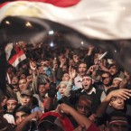 Egyptians celebrate the news of the resignation of President Hosni Mubarak this evening after weeks of protest against 30 years of emergency rule.<span class=