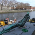 The Anna Livia statue begins the trip by barge down the Liffey that she is named for to her new home at the Croppy Acre.