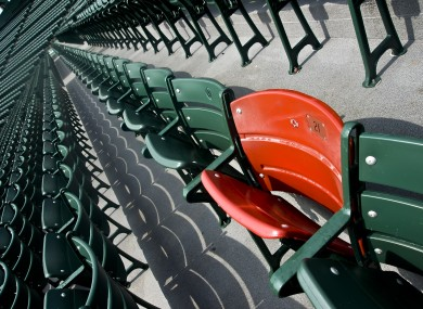 The lone red seat in the right field bleachers which signifies the spot where the longest measurable home run ever hit inside Fenway Park. Ted Williams hit the home run in 1946.