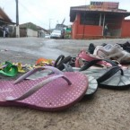 The shoes of victims of an accident during a carnival parade lie on the street in Bandeira do Sul in Brazil. They were electrocuted and 60 others were injured when a high voltage cable broke and hit a carnival float. Pic: Alex de Jesus/Agencia Estado via AP Images.