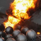 Giant fireballs rise from a burning oil refinery in Ichihara, Chiba Prefecture. (PA Images)