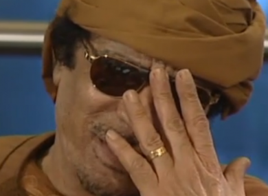 Muammar Gaddafi laughs at an interviewer's suggestion that he leave Libya, from a clip aired by the BBC.