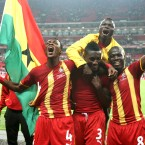 Asamoah Gyan, Andre Ayew, and John Pansil celebrate their draw against England. <span class=