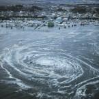 Tsunami swirls near a port in Oarai, Ibaraki Prefecture, Japan. (AP Photo/Kyodo News)
