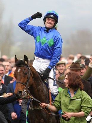 Ruby Walsh celebrates on Hurricane Fly after winning the Stan James Champion Hurdle Challenge Trophy on Centenary Day at Cheltenham.