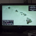 A computer screen at the Pacific Tsunami Warning Center shows the islands of Hawaii, Thursday, March 10, 2011 in Honolulu. Hawaii is under a tsunami warning. (AP Photo/ Marco Garcia)