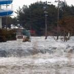 The tsunami strikes Iwaki, Fukushima Prefecture. (AP Photo/Kyodo News)
