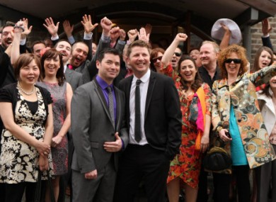 Hugh Walsh and Barry Dignam celebrate with friends and family after entering one of Ireland's first same-sex civil partnerships today.