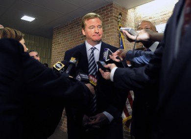 NFL Commissioner Roger Goodell talks with reporters.