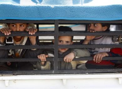 Libyan children cross the Libya-Tunisian border in an effort to escape fierce fighting