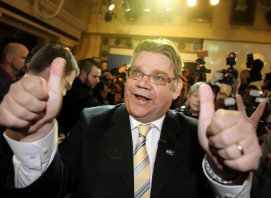 Timo Soini of the True Finns celebrates with supporters after his party recorded massive gains in the country's parliamentary elections.