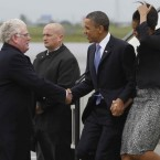 U.S. President Barack Obama and first lady Michelle Obama are greeted by Eamon Gilmore as they step off Air Force One as they arrive in Dublin. 