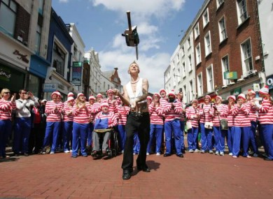 The Space Cowboy in Dublin juggles with a chain saw in front of a bunch of Wallys as he launch the Street Performance World Championship taking place next month.
