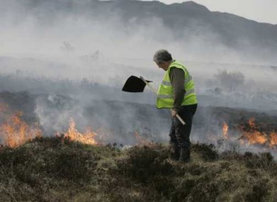 Coillte firefighter Tony Clarke battles a gorse fire outside Pontoon in Co Mayo.