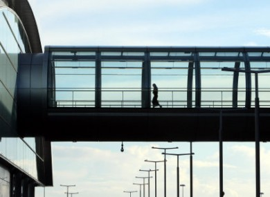A passenger crosses a walkway at Dublin Airport - an average of 12 women a day are travelling from Ireland to England an
