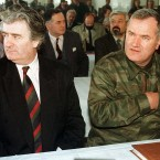 In this undated file photo Bosnian Serb Leader Radovan Karadzic and General Ratko Mladic attend an assembly session near Sarajevo. <span class=
