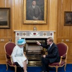 Taoiseach Enda Kenny chats to the Queen under the watchful eye of Michael Collins, director of intelligence in the old IRA during the War of Independence, and later signatory of the Anglo-Irish Treaty in 1921. (Pic: Mark Cuthbert/UK Press/Press Association Images)