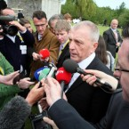 Jackie McDonald, leader of the Ulster Defence Association (UDA), speaks to the media (and Charlie Bird) after attending the laying of wreaths at the War Memorial Gardens. (Pic: Paul Faith/PA Wire/Press Association Images)