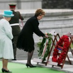 President Mary McAleese lays a wreath as Queen Elizabeth II looks on at a ceremony in the grounds of the Irish War Memorial Garden, Islandbridge. (Pic: Maxwells)
