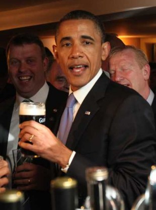US President Barack Obama enjoys a pint in Ollie Hayes' pub in Moneygall