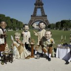 Oxfam international activists pose as G-8 leaders in Paris as the real heads of state were meeting in the nearby city of Deauville. (AP Photo/Laurent Cipriani)
