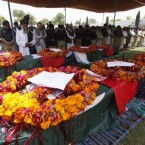 People attend the funeral of victims who lost their lives in a suicide bombing in Peshawar, Pakistan. (AP Photo/Mohammad Sajjad)