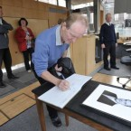 Joe Drein from Templelogue signs the book of condolence for Brian Lenihan today<span class=