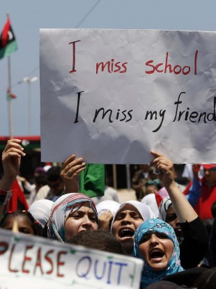 School students chant slogans against Muammar Gaddafi, during a demonstration, at the court square in the rebel-held capital Benghazi, Libya
