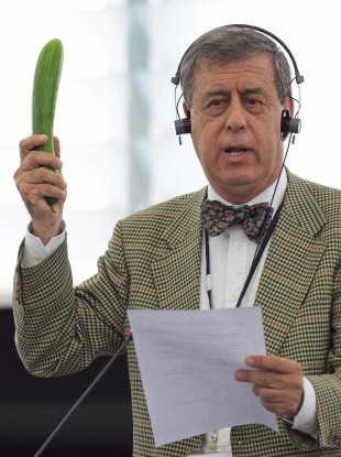 Spanish Member of Parliament Francisco Sosa Wagner holds up a cucumber during a Plenary Session debate on the recent outbreak of E.coli at the European Parliament in Strasbourg
