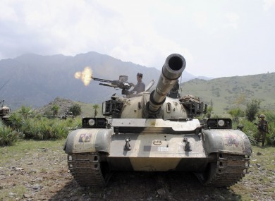 A Pakistani Army tank fires during an action against militants