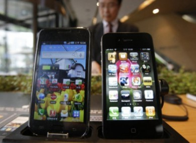 Spot the difference: Samsung's Galaxy S is on the left and Apple's iPhone 4 is on the right.