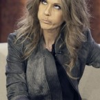 Celine Dion gargles the tune of one of her songs after she lost a bet during the German TV show