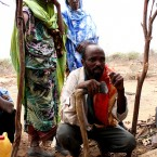 Ali-Dahir Muhammed in Hindeysa village receives water from a new borehole.