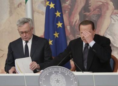 A headache for Silvio: Tremonti and Italian PM Silvio Berlusconi announce €47bn austerity measures yesterday