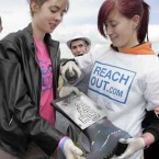 Carmel Sayers, left, gets her wellies pimped by Liz Murray at the ReachOut.com stall