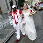 Jeannette Coleman, right, holds back tears as she and Kawane Harris, arrive to get married. (AP Photo/Jason DeCrow)