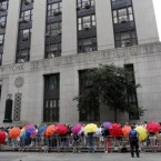 Same sex couples wait in line to receive marriage licences at the Manhattan City Clerk's office in New York yesterday. (AP Photo/Jason DeCrow)