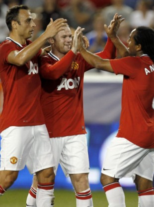Rooney celebrates with Anderson and Berbatov after the opening goal.